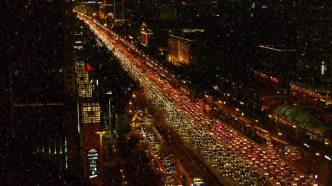 traffic on busy overpass in snow night,modern urban city Footage