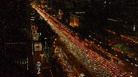 traffic on busy overpass in snow night,modern urban city Stock Video Footage
