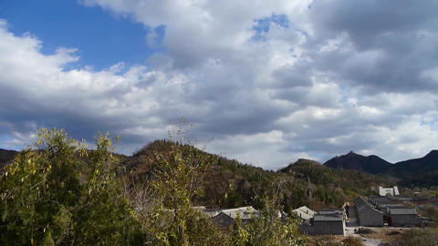 Panoramic of sunny village mountains,Altocumulus cloud in blue sky Footage