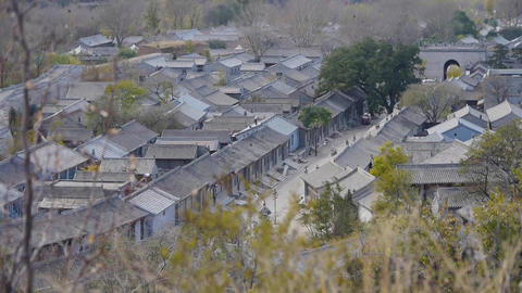Chinese ancient buildings village & swing grass in autumn Footage