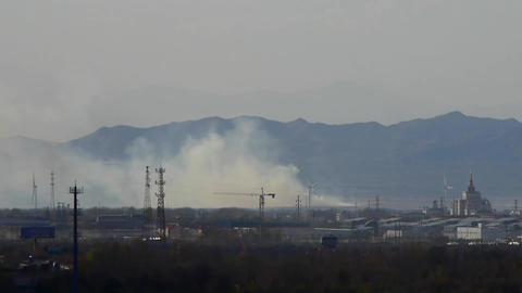 Panoramic of city town & factory smoke rely on mountain,industrial tower at  Footage