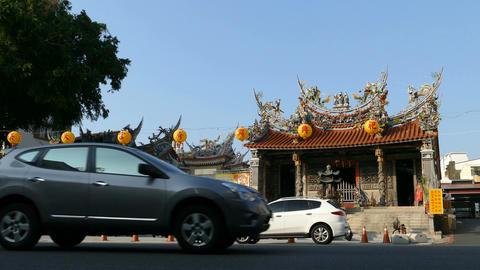 Da Guan Yin Ting temple at busy street Live Action