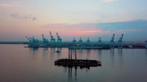 Aerial drone. Flight to container port with big container ships and cranes at Live Action