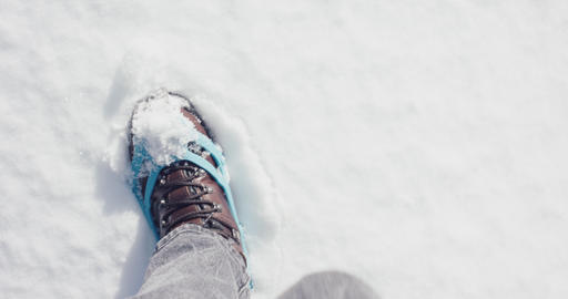 Hiking boots in crampons walk on fresh snow winter pov point of view Live Action