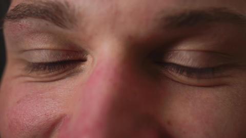 Closeup of man eyes, man has beautiful brown Eyes. Natural Beauty. Man smiling Live Action