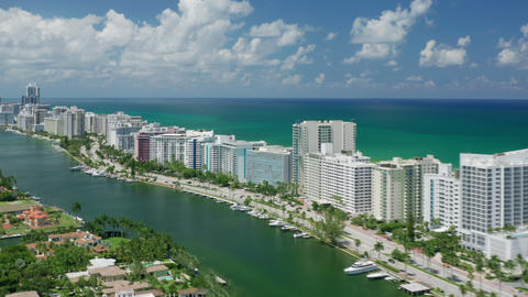 Miami beach cityscape hyper lapse on sunny summer day. Scenic white city aerial Live Action