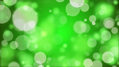 Holiday animation spring green background with flying round sequins Animation