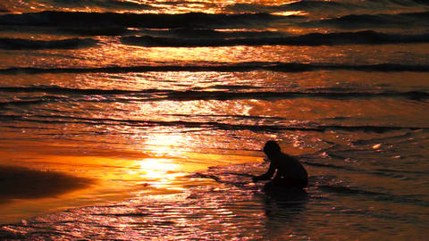 Two Kids Playing on the Beach at Sunset Stock Video Footage