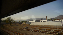 factory chimney & mountain in rural countryside,Speeding train travel,scener Footage