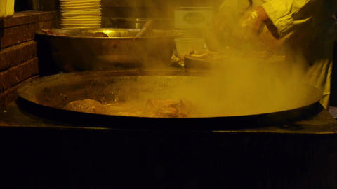 China Tradition Gourmet,pot Roast In Cauldron,chef Cutting Cooked Meat stock footage