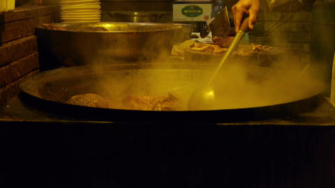china tradition gourmet,pot roast in cauldron,chef cutting cooked meat Footage