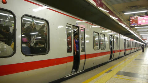 Beijing subway station,busy people crowd inside of train... Stock Video Footage