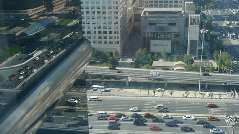 Aerial view of overpass traffic in city,reflect on glass window Footage