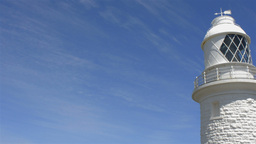 Lighthouse Set Against the Blue Sky with Light Clouds Stock Video Footage