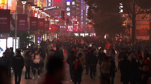 Slow Motion Of A Busy Night Crowds Traffic On Nanjing Road stock footage