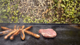 Cooking Steaks and Sausages on a Barbecue Footage