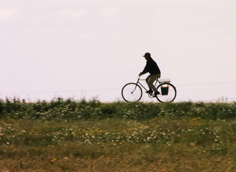 Rural Bicyclist stock footage