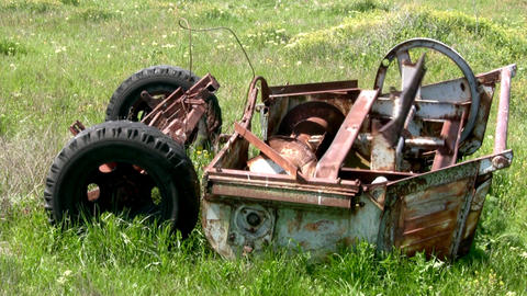 Old machinery in the grass Stock Video Footage