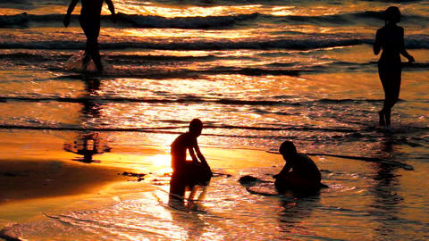 Playing Walking on the Beach at Sunset Stock Video Footage