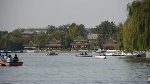 People boating on lake at China Beijing Beihai Park... Stock Video Footage