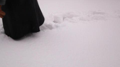 Elderly woman walking in a snow 3 Stock Video Footage