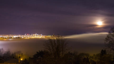 Foggy Night Covering Vancouver Downtown with Moon Stock Video Footage