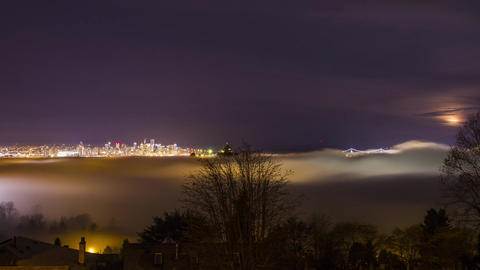 Foggy Night Covering Vancouver Downtown with Moon  Footage
