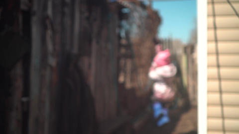 Blurred video, abstraction. Child Swings On A Swing. The Child Sways and Plays Live Action