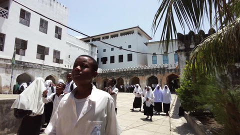 Inside an African high school, Group of students in school uniforms in Yard Live Action