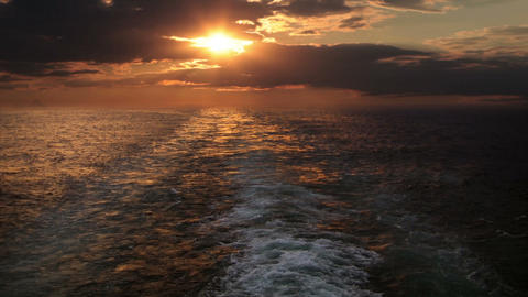 Sunset and wake of a ship Stock Video Footage