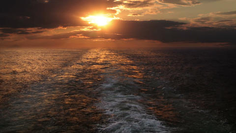 Sunset and wake of a ship Footage