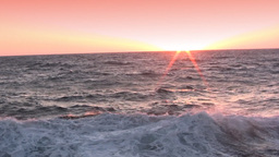 Spatter of waves at sunset Stock Video Footage