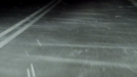 Driving a car during snowfall at night. View at the road Stock Video Footage