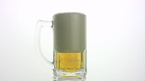 The beer is poured in a mug. White background Stock Video Footage