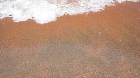 Wave Foam on a Sandy Beach Stock Video Footage