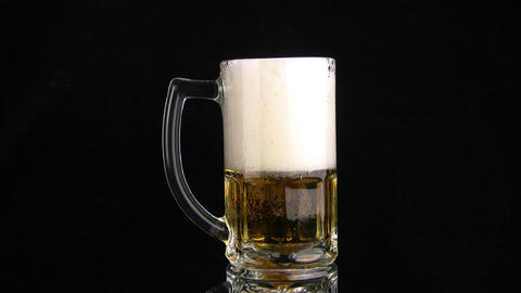 The beer is poured fast through edge of mug Stock Video Footage