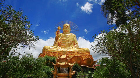 Closeup Large Gold Buddha Statue against Blue Sky in Vietnam Footage