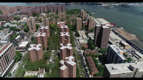 Manhattan east village aparment buildings with manhattan bridge in background Live Action