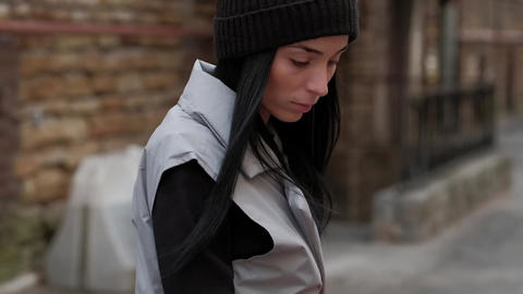 Stylish Fashion Girl, With Long Black Hair, Walking in the Street Live Action