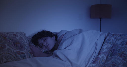 Woman asleep in bed Live Action