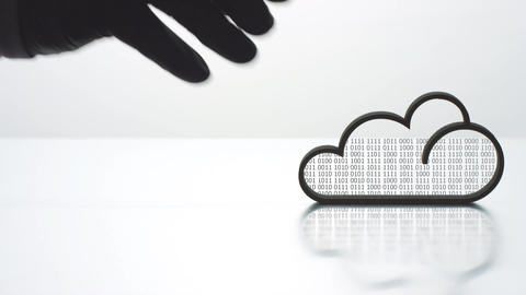 CLOUD COMPUTING text and backlit cloud icon Live Action