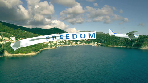 Plane with flying banner with FREEDOM text on summer sea background Live Action