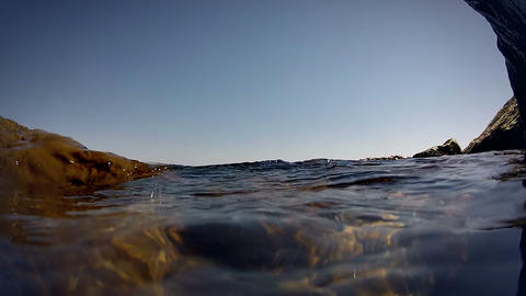 Surf wave on the rocky shore. Close-up Stock Video Footage