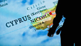 Crisis In Cyprus. A Man And A Map Of Cyprus stock footage