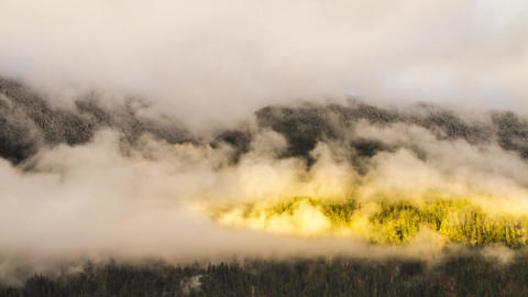 Misty Cloudy Morning with Sun Light Shining on Mou Stock Video Footage