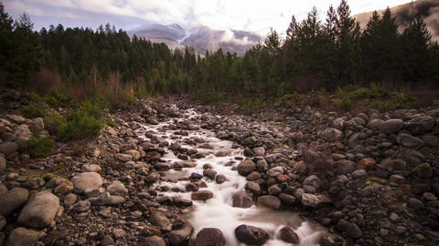 Misty Clouds on a Snowy Mountain Top and River Run Stock Video Footage