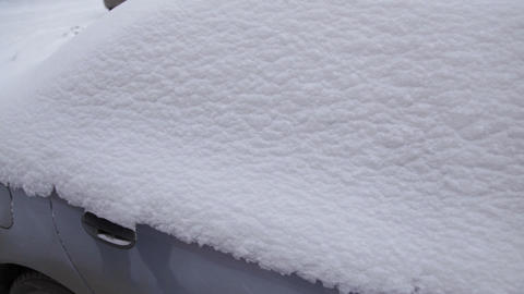 Car in snow, person sits in the snow-covered car Stock Video Footage