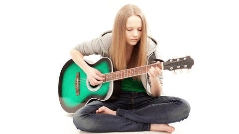 Guitarist, Girl Playing A Guitar While Sitting On The Floor, TimeLapse stock footage