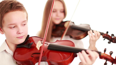 Two teenager playing the violin Stock Video Footage