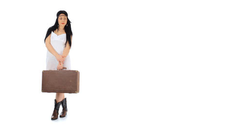 Sad girl with a suitcase waiting Stock Video Footage